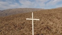 Aerial video of a cross on a mountainside.  Multiple clips from different angles and flying camera movements.   Filmed with a DJI Phantom 3 Professional quadcopter drone.