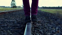 balancing walking on the tracks