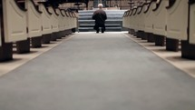 Walking the aisle and kneeling at the altar.