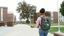 teen girl walking to class