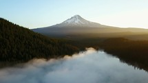 rising fog over a mountain lake