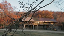 Rustic cabin in the fall foliage.