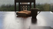 closed Bible and a steaming cup of coffee