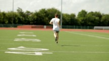 Man running on a football field.