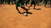 children playing soccer outdoors in Kenya