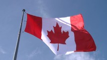 Canadian flag wavering in the wind.