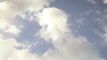 timelapse of clouds moving in the blue sky