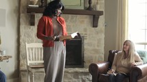 Leader sharing at a women's Bible study in a home.