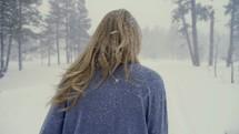 woman walking outdoors during a snowfall