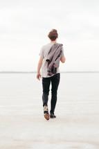a man walking away over the great salt plains