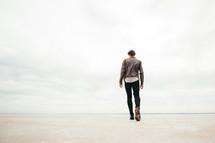a man walking away on the great salt plains