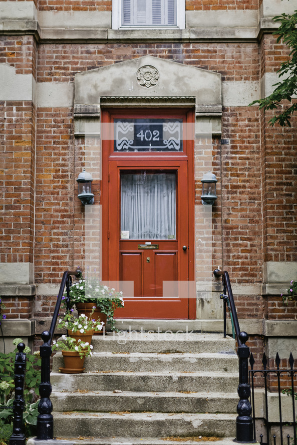 red front door on a townhouse