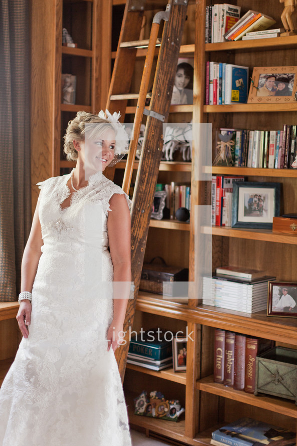 Bride standing in a library