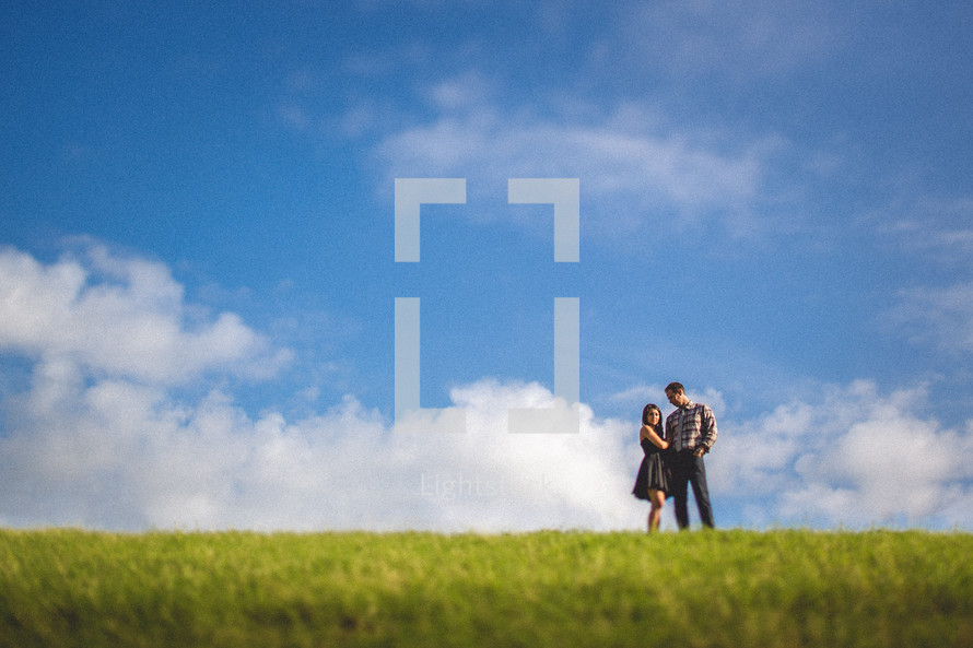 A couple in a grassy field
