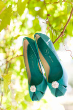 Bright blue shoes hanging in a tree