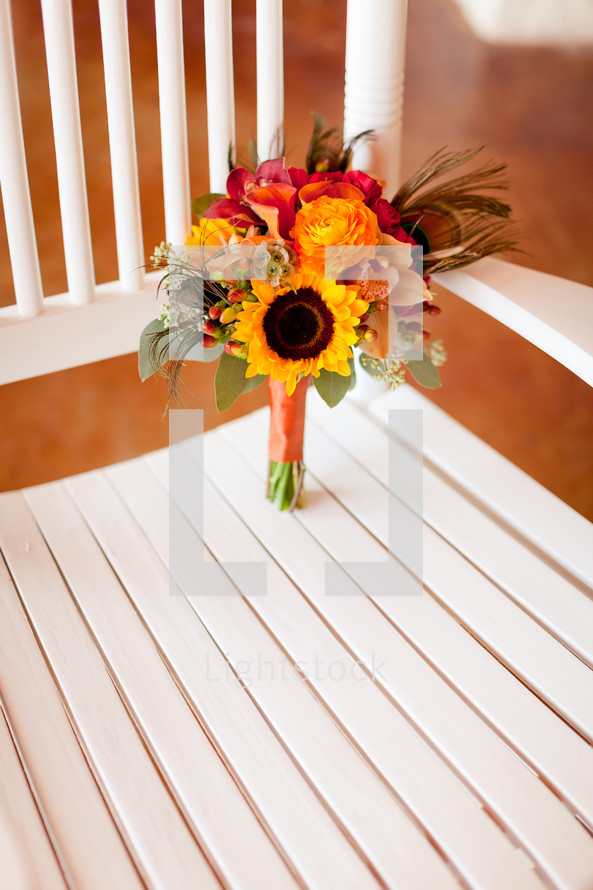 Bouquet of flowers in a chair