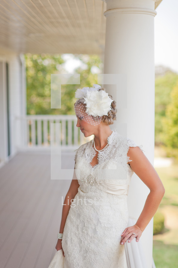 Bride standing on a large porch