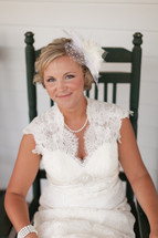 Bride sitting in a rocking chair