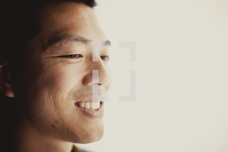 A smiling Asian man