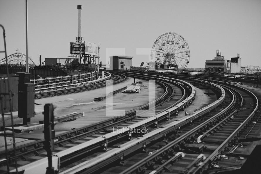 Train tracks by amusement park