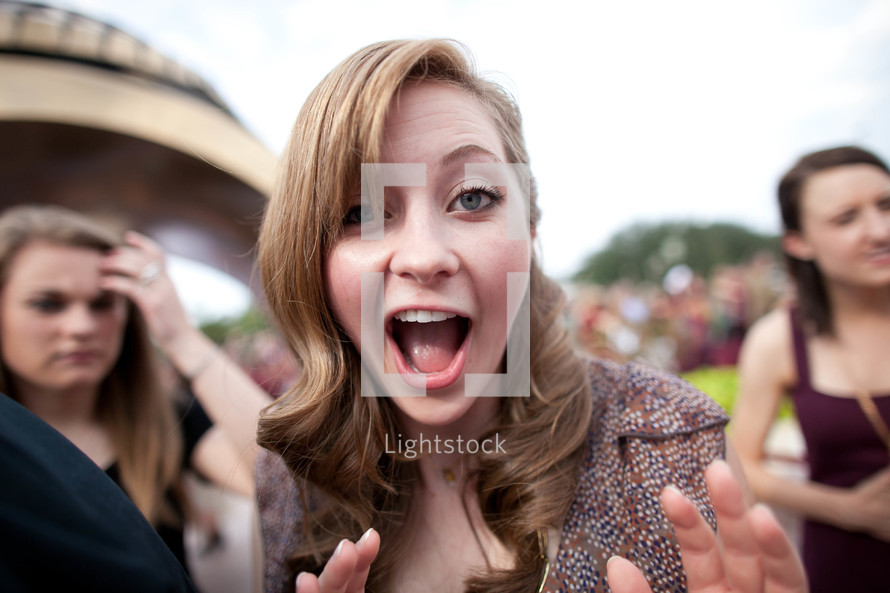 woman making a surprise face with mouth open