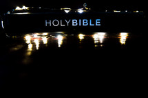 Holy Bible and fairy lights