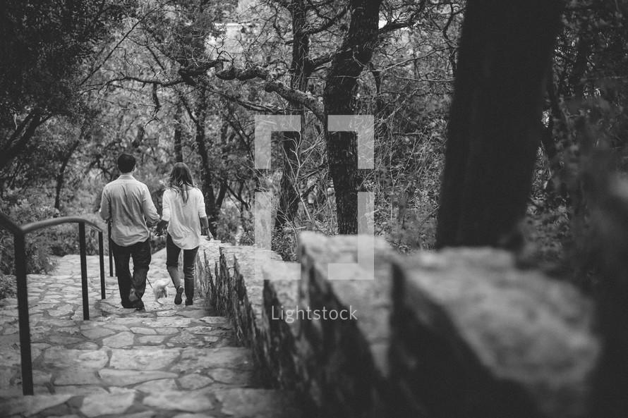 Couple walking down a stone staircase
