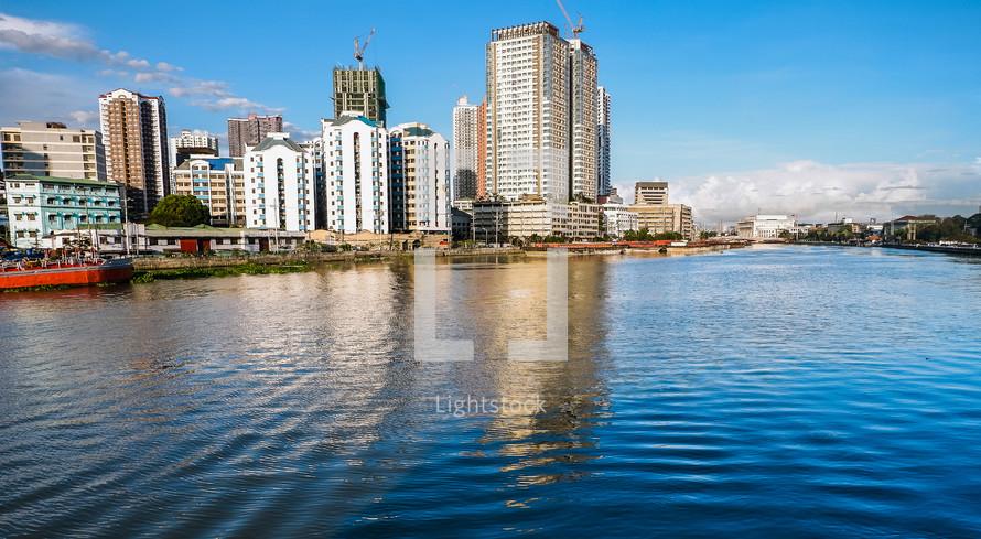 city buildings beside a river