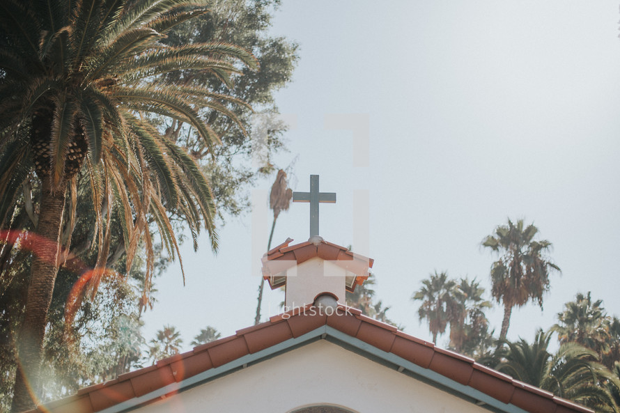 cross topper on the roof of a church