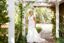 Bride standing in a garden