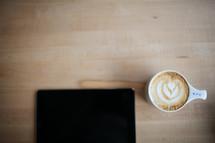coffee and creamer and an iPad screen