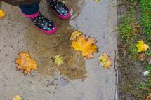 a little girl in rain boots