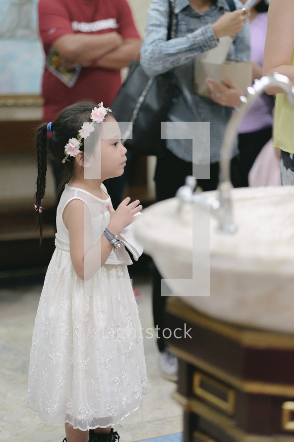 a little girl at a baptism