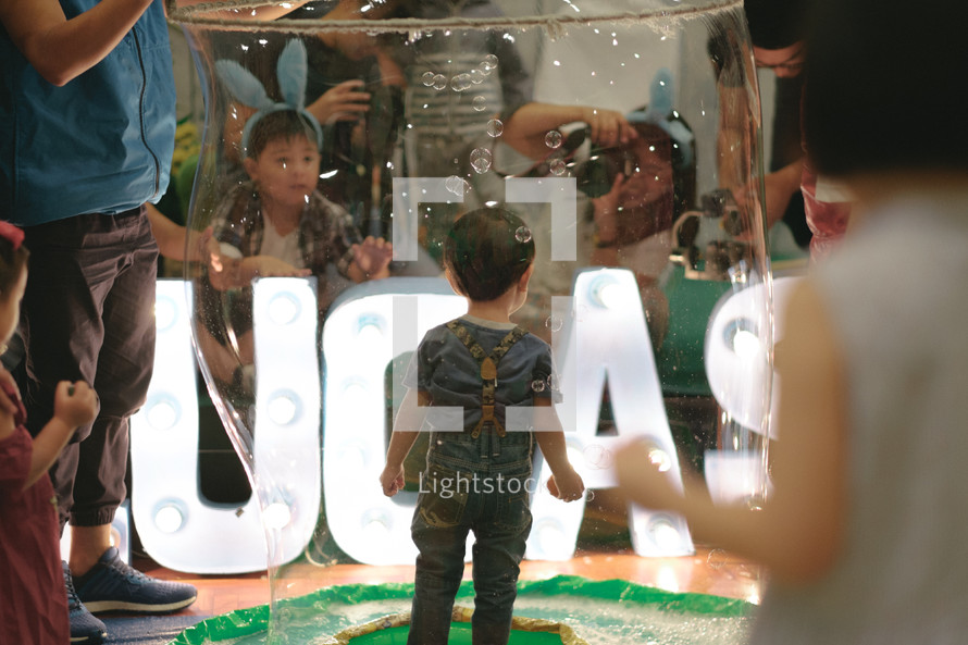 children playing with bubbles at an Easter festival