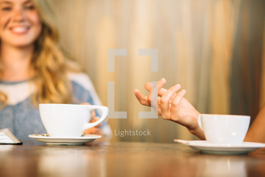 friends sitting together drinking coffee