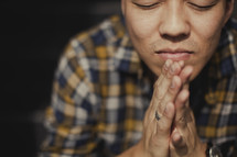 Young Asian man praying