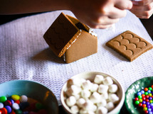 decorating gingerbread houses at Christmas