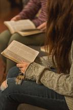 teen girls reading a Bible at a Bible study
