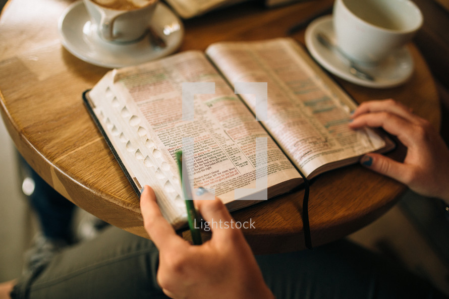 Studying the Bible over coffee.