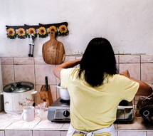 a woman kicking in a kitchen