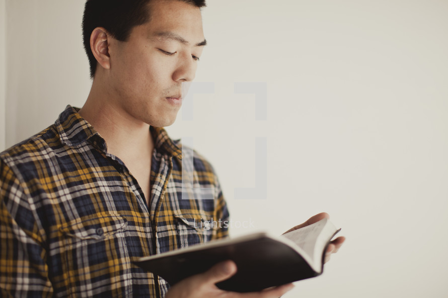 Asian man reading bible