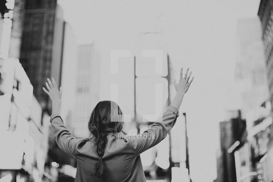Woman hailing taxi cab