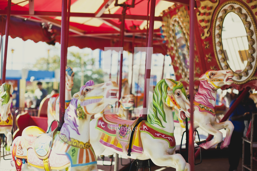 A carousel with horses