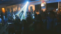jumping and cheering youth in worship at a youth rally