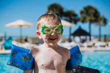 toddler boy in a swimming pool