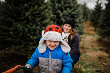 mother and son in a Christmas tree farm