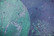 blue green painted on to asphalt - texture - circles