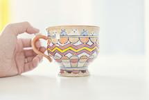 hand on a tea cup