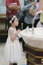 a little girl at a baptism