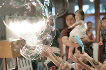 children playing with giant bubbles